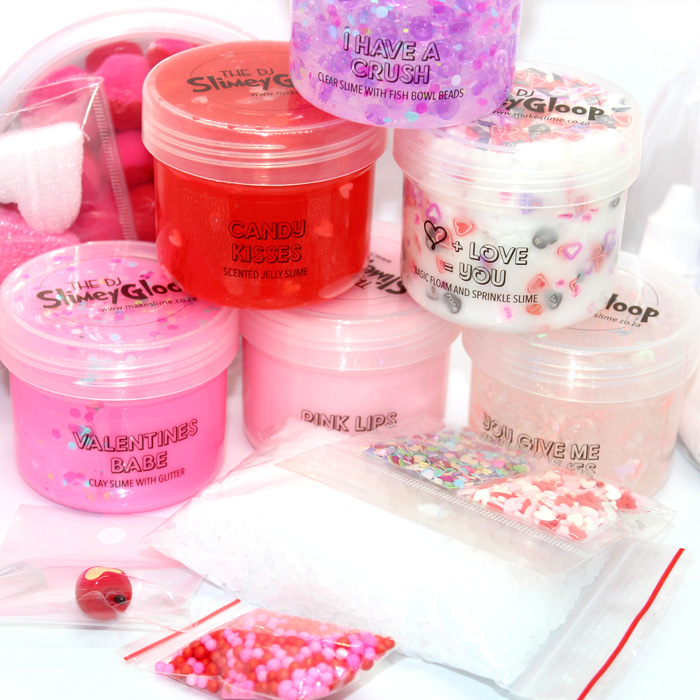 Baby pink strawberry scented basic slime, clear fishbowl bead and butterfly glitter slime, bright pink clay slime.